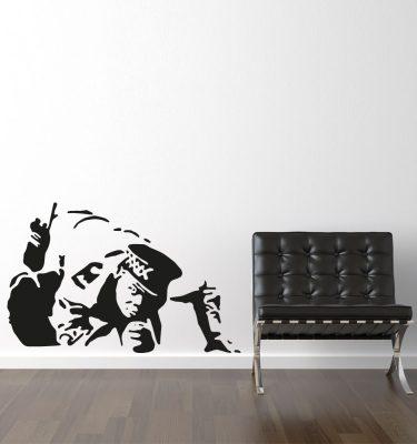 Sniffing cop - Banksy